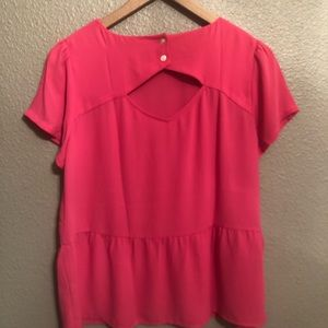 Tops - pink peplum top with a cute back.